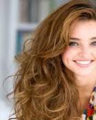 Manechinul Miranda Kerr: Zambetul este cheia secretului frumusetii unei femei