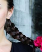woman-with-braid-flower-clasp.jpg